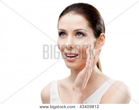 Woman putting on lifting cream on her face, isolated on white. The pursuit of beauty