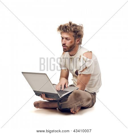 tramp sitting on the floor with laptop