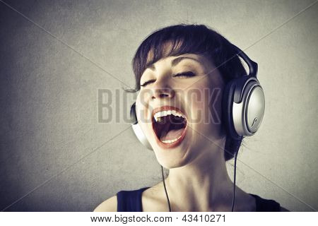 portrait of woman with headphones music singing
