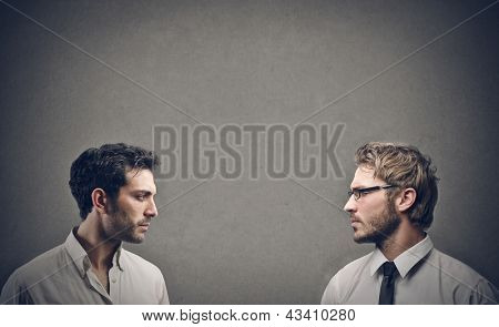 profile of two businessmen looking at each other