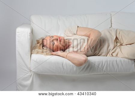 aged woman sleeping on the sofa