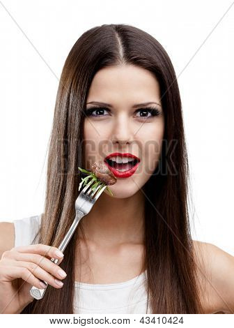 Pretty woman with red lipstick eating roast meat, isolated on white. Greasy food leads to obesity