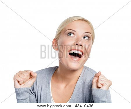 Girl with her fists up, isolated on white. Sign of happiness and success