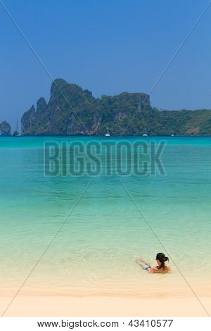 Young womand relaxing at the beach in Phi Phi island in Thailand