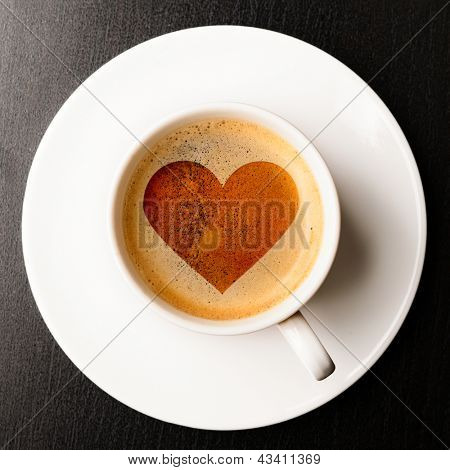 loving coffee. cup of fresh espresso with heart sign, view from above