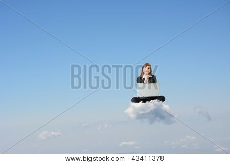 Business woman sit on cloud and use laptop over sky.
