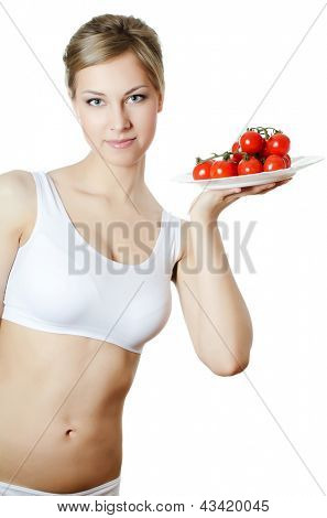 The beautiful girl with plate with vegetables