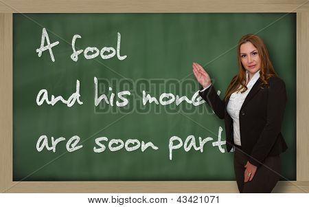 Teacher Showing A Fool And His Money Are Soon (easily) Parted On Blackboard