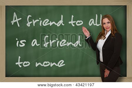 Teacher Showing A Friend To All Is A Friend To None On Blackboard