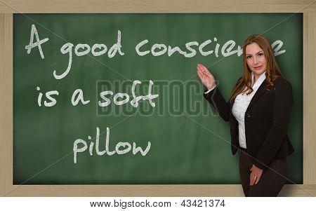 Teacher Showing A Good Conscience Is A Soft Pillow On Blackboard