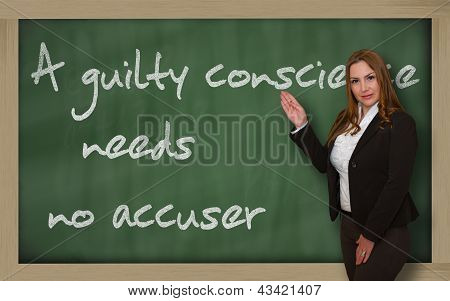 Teacher Showing A Guilty Conscience Needs No Accuser On Blackboard