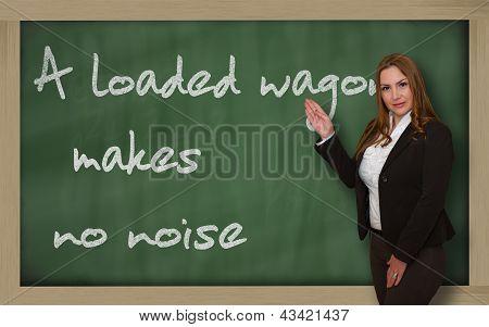 Teacher Showing A Loaded Wagon Makes No Noise On Blackboard