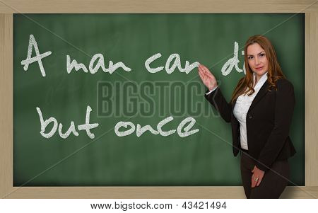 Teacher Showing A Man Can Die But Once On Blackboard