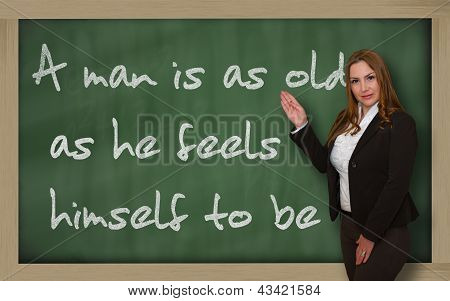 Teacher Showing A Man Is As Old As He Feels Himself To Be On Blackboard