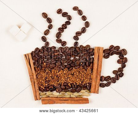 Cup made of coffee beans with lump sugar on the light canvas