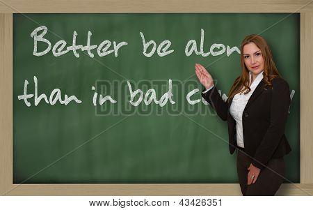 Teacher Showing Better Be Alone Than In Bad Company On Blackboard