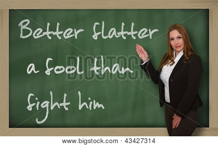 Teacher Showing Better Flatter A Fool Than Fight Him On Blackboard