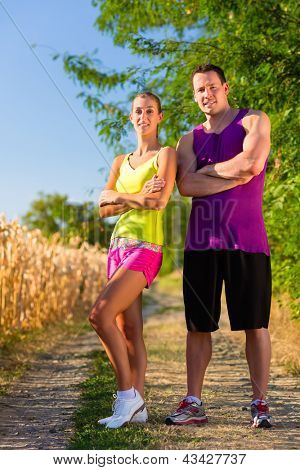 Rural sports - couple jogging for fitness on a beautiful summer day