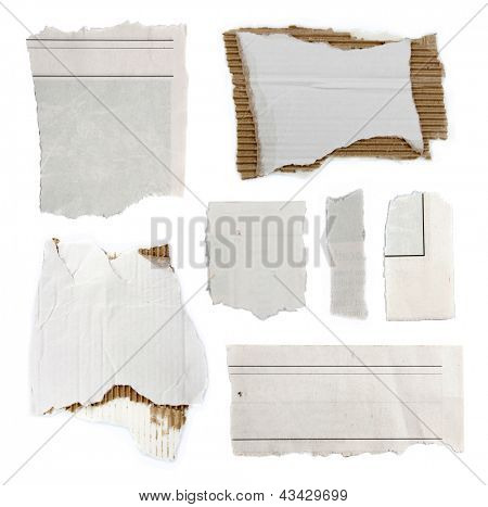 Pieces of torn paper and cardboard on plain background. Copy space