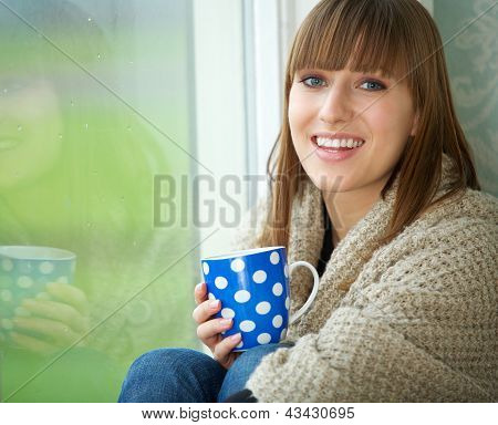 Pretty Woman Smiling With Cup Of Tea