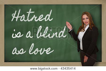 Teacher Showing Hatred Is A Blind As Love On Blackboard