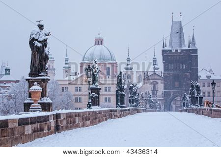 snow morning at Charles bridge in winter, Prague, Czech Republic