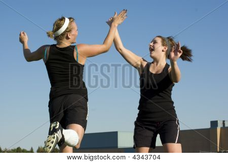 Soccer Girls Celebrate With A High Five