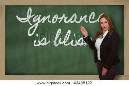 Teacher Showing Ignorance Is Bliss On Blackboard