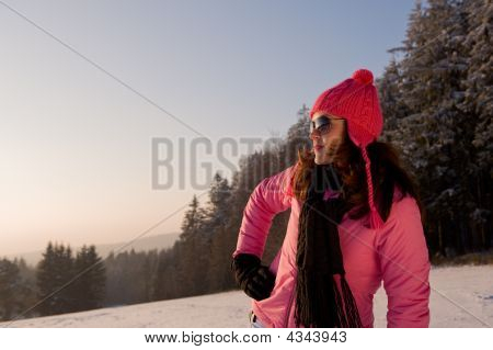 Fashion Model Watching Winter Sunset