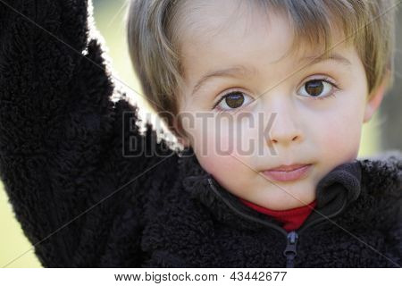 Three year old portrait of innocence outdoor in the sunlight