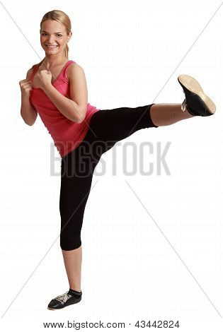 Young Blonde Woman Kickboxing