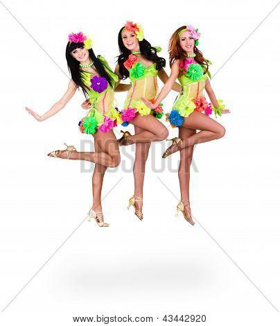 three beautiful carnival dancers women jumping