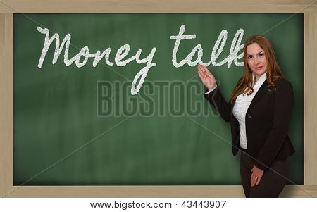 Teacher Showing Money Talks On Blackboard