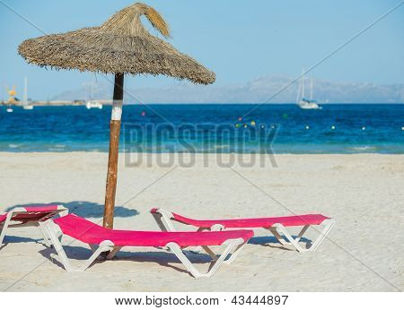 Chairs and umbrella on the beach.