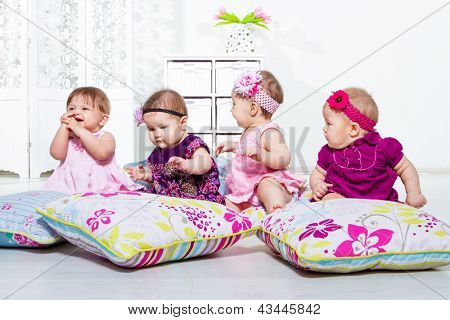 Four little girls group sitting together