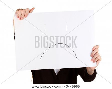 Woman holding paper with sad emoticon, isolated on white