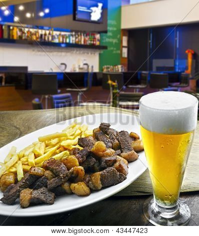 beer served with roast beef and potatoes