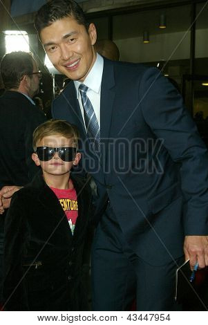 LOS ANGELES - MARCH 18: Rick Yune meets and signs an autograph for an unidentified fans at the premiere of