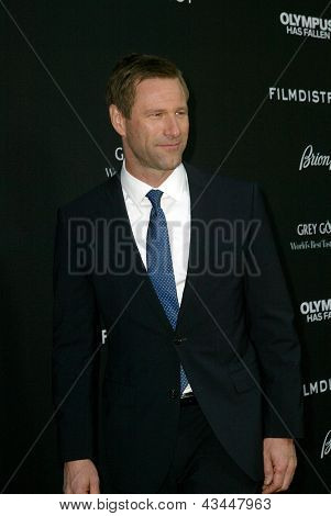 """LOS ANGELES - MARCH 18: Aaron Eckhart arrives at the premiere of """"Olympus Has Fallen"""" at the ArcLight Hollywood Theatre in Los Angeles, CA on March 18, 2013."""