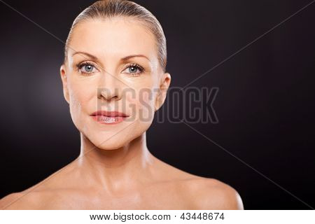 pretty middle aged woman on black background