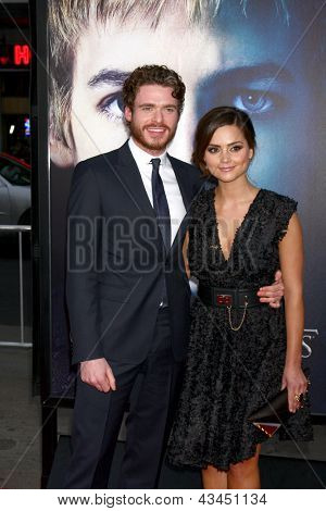 LOS ANGELES - MAR 18:  Richard Madden, Jenna-Louise Coleman arrive at