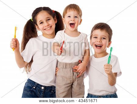 Happy family with toothbrushes