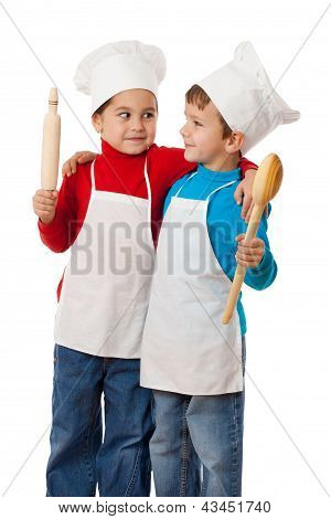 Little cooks with ladle and rolling pin