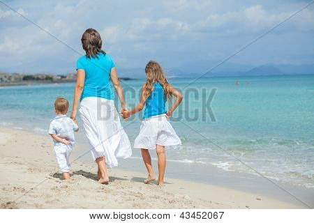 Mother with his two kids on beach