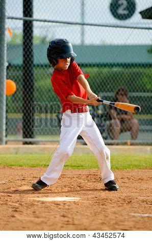 Youth Baseball Player Swinging Bat