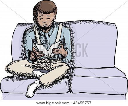 Menino lendo um livro