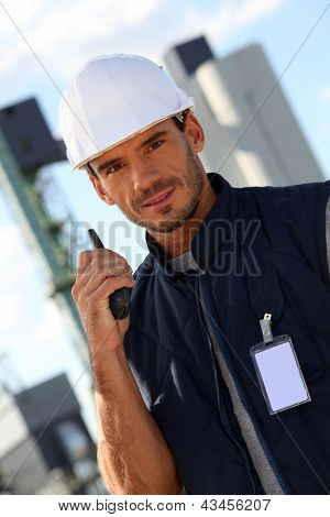 portrait of foreman with talkie walkie in construction site