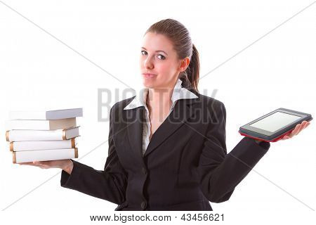 Woman having dilemma between stack of books and ebook reader