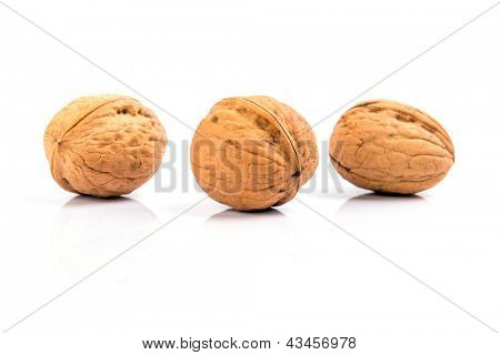 Walnuts close up over white background