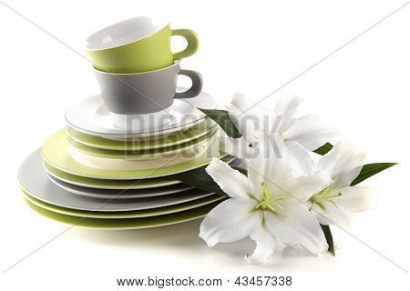 Empty plates and cups isolated on white